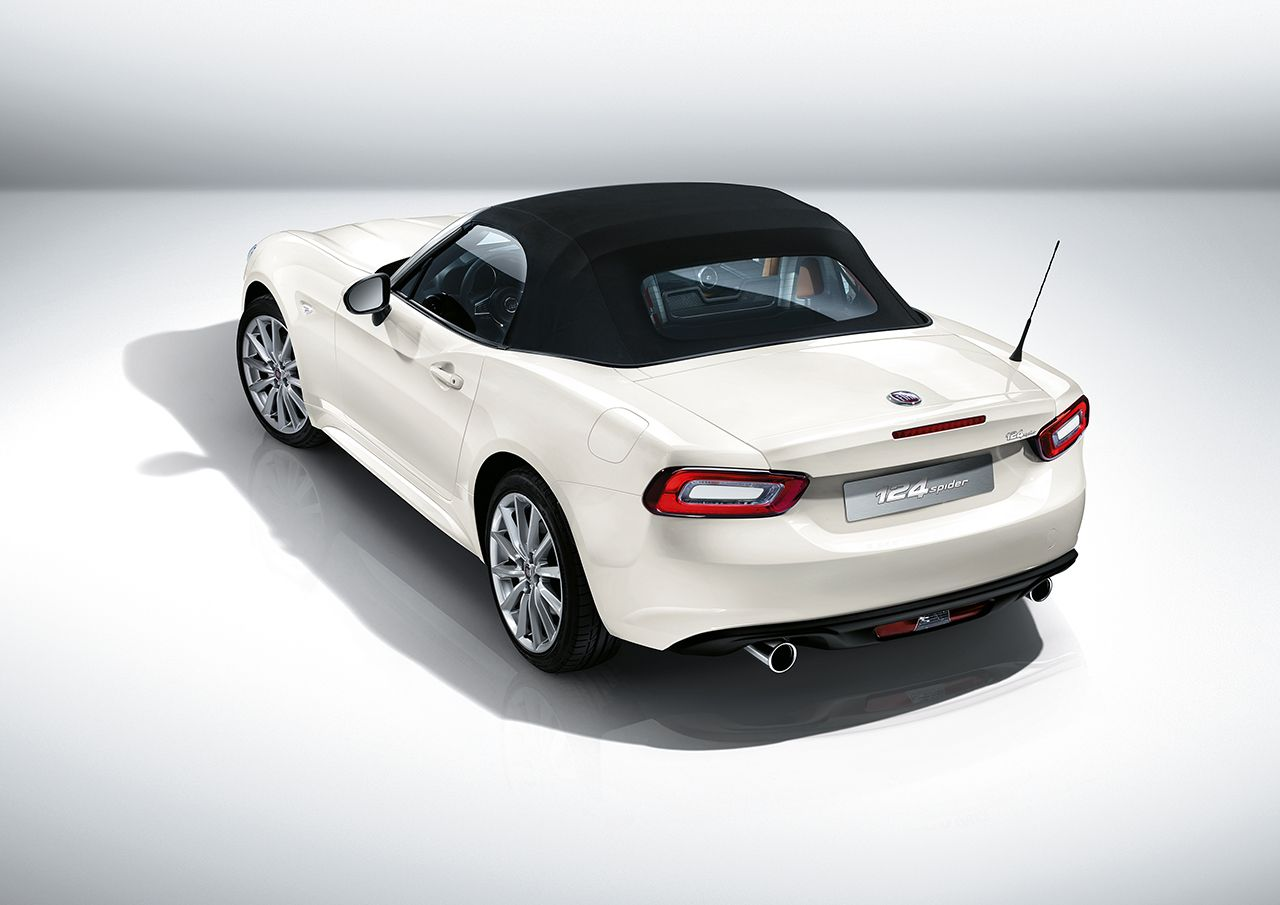 Fiat 124 Spider white hood up